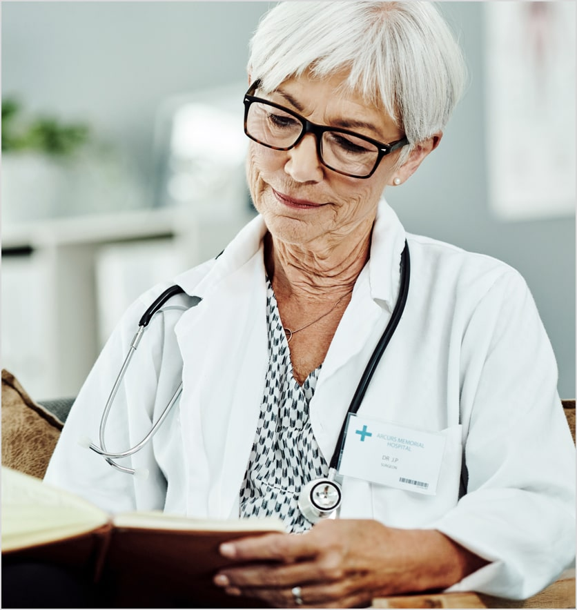 doctor with stethoscope reading book